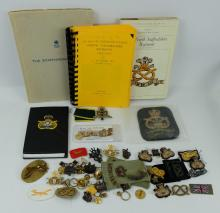A collection of items related to the North Staffordshire regiment including cap badges, cloth badges, books and boxes etc