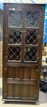 Oak glassed fronted corner unit in the priory style