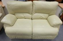 Cream reclining 2 seater settee