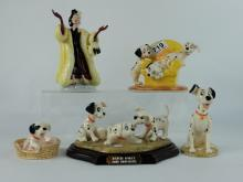 A collection of Royal Doulton Dalmatians from the Walt Disney collection to include Pongo DM6, Patch in Basket DM9, Pups in the Armchair DM11, Patch, Rolly and Freckles tableau on wooden base DM5 and Cruella De Vil DM1 all boxed (5)