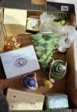 A collection of Royal Doulton items to include Winnie the Pooh figures WP36 and WP43, Snowman figure Mrs Frostys Finishing Touch FF2 together with pottery christmas tree light and Wedgwood trinket box (5)