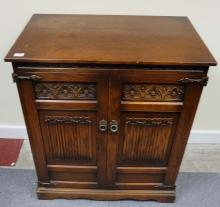 Carved oak linen fold two door TV cabinet