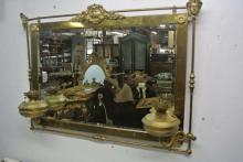 ENGLISH BRASS MIRROR WITH HURRICANE LAMPS