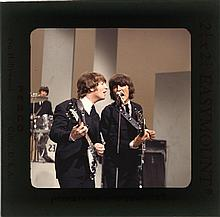 (6) Vintage color camera transparencies of The Beatles on the Ed Sullivan Show, copyrights included.