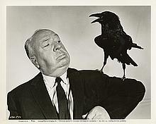 Collection of (10) photos of Alfred Hitchcock directing or posing.