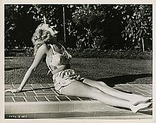 Oversize double-weight portrait of Betty Grable in classic bathing beauty pose.