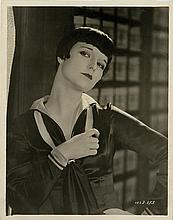 Vintage Louise Brooks photograph from Love 'em and Leave 'em with notes in her hand.