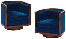 Blue velvet (2) round chairs from the interior of the Capitol train in  The Hunger Games .