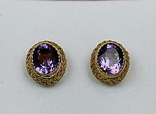 PAIR OF GILT SILVER EAR STUDS INLAID WITH PURPLE CRYSTLE