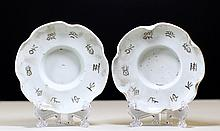PAIR OF GILT WHITE GLAZED PORCELAIN SAUCERS