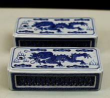 PAIR OF BLUE AND WHITE PORCELAIN PAPER WEIGHTS