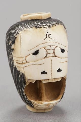 An ivory netsuke of a lantern.