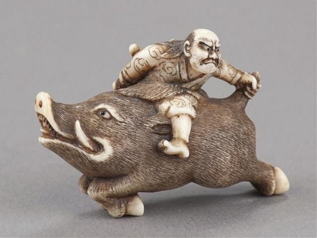 An ivory netsuke of Nitta no Shiro killing the boa