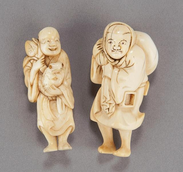 A group of two carved ivory netsuke.