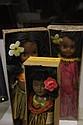 Three Hawaiian dolls. A group of three Hawaiian dolls including two Momi Pearl Waikiki Girl dolls and one hula doll.
