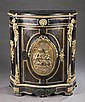 Ebonized wood bowfront cabinet w/ figural plaque