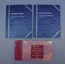 Jefferson nickels and coinage. A group of two Jefferson nickel books & . ++ A group of two Jefferson nickel collection books. Includes 93 coins ranging from 1938-1961. ++ A Thomas Jefferson coinage and currency set including anniversary silver