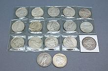 A lot of Peace Dollar Coins. A lot of 17 Peace dollar coins.Condition: good.