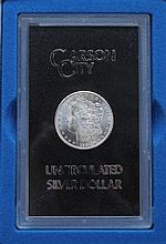 U.S. 1884 Carson City Morgan Dollar Coin United States Carson City Morgan silver dollar coin. 1884. Uncirculated. In display case.Condition: Perfect.