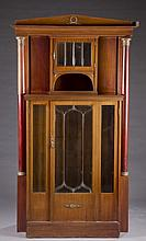 Revival style cabinet.