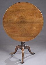 Tilt top tea table.