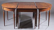George III style mahogany three-part dining table.