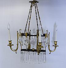 Neoclassical style four-light chandelier.