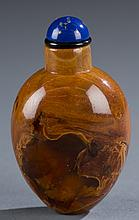 A Chinese ovoid form amber snuff bottle.