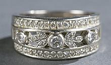 Large ladies diamond and 14kt white gold band.