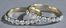 Pair of 0.75tcw diamond and 14kt gold bands.