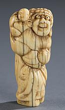 A Japanese ivory netsuke of a man with child.