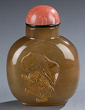 A Chinese agate snuff bottle.