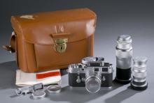 Leica M3 double stroke camera in case with lenses.