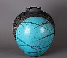 Studio art pottery vase with pierce work.