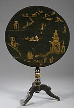 A Chinoiserie style lacquer Tilt-top round table.