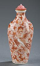 A Chinese porcelain snuff bottle.