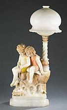 A marble and carved alabaster figural lamp.