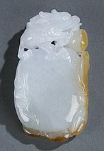 A Chinese jade pendant carved with dragon.