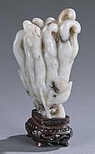 A Chinese jade carving of Buddha hand fruit.