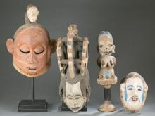 3 African masks and 1 staff, 20th century.