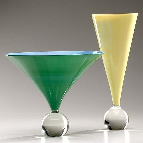 LAURA DIAZ DE SANTILLANA / VENINI Two flaring glass vases on clear ball feet, one green and blue, the other yellow and cream, 1983-4. Engraved Venini Italia Laura and dated, labels. 9 1/2