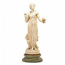 CONTINENTAL IVORY FIGURE; Woman holding a bouquet