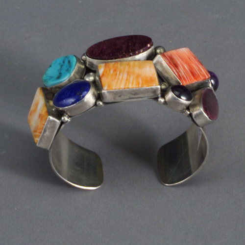 SAM PIASO sterling silver cuff bracelet, cabochon-set with nine semi-precious stones. Stamped Sterling/Sam Piaso. Inside dia.: 2 3/8