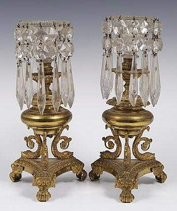 Pair of Regency ormolu and cut glass candlesticks,