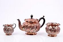 Victorian silver three piece bachelor tea set, comprising teapot of bullet form, with embossed wryth