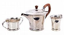 Unusual heavy gauge contemporary silver three piece tea set, comprising large teapot of flared cylin