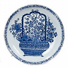 Early 18th century Chinese export blue and white porcelain charger painted with central basket of fl