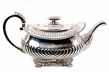 George III silver teapot of wrythen fluted form, with gadrooned border and silver loop handle with i