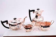 1930s four piece silver tea set comprising teapot of fluted form, with ebonised angular handle and d