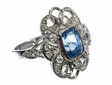 Sapphire and diamond cocktail ring with a central cushion cut cornflower blue sapphire estimated to